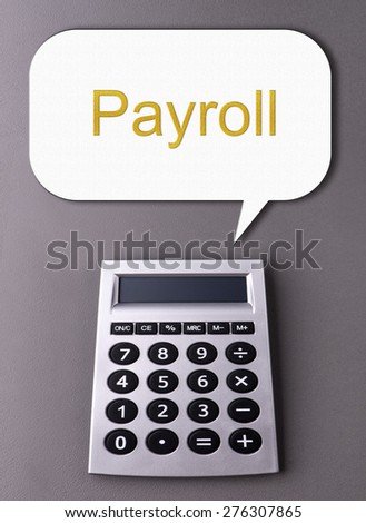 calculator with conversation icon showing - Payroll - stock photo