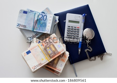 Calculator with diary, euro bills and pen  - stock photo