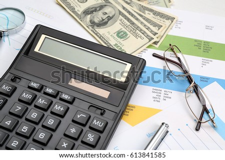 Calculator with documents, closeup. Tax concept