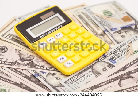 Calculator with dollars - stock photo