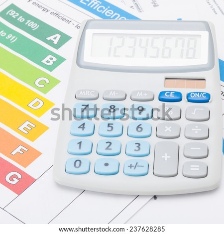 Calculator with energy efficiency chart - accounting concept - stock photo