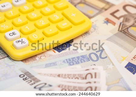 Calculator with Euro notes - stock photo