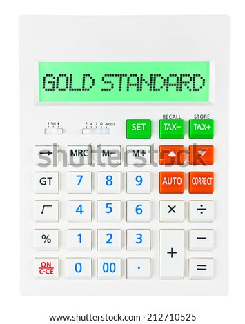 Calculator with GOLD STANDARD on display on white background - stock photo
