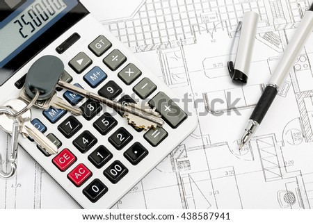 calculator with house keys on blueprint