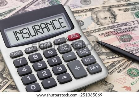 Calculator with money - Insurance - stock photo