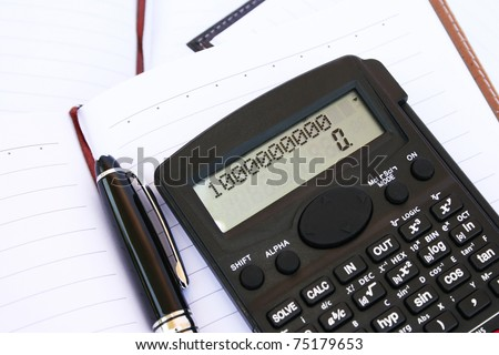 Calculator with one million, pen and notebook. - stock photo