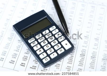Calculator with pen - stock photo
