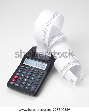 Calculator with roll of adding machine tape - stock photo