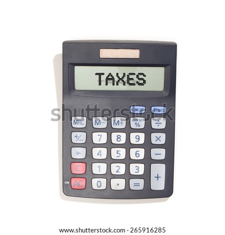 Calculator with solar energy cells, reading Taxes on the screne. Black with grey keys. Top view, isolated on white background. - stock photo