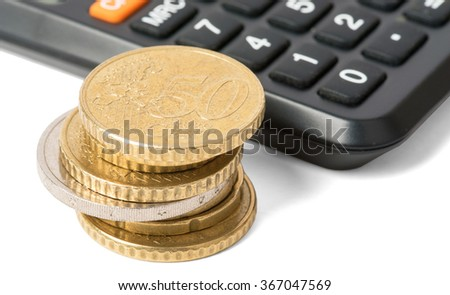 Calculator with stack of coins