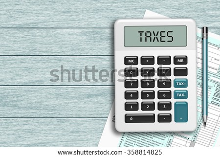 calculator with taxes text  and 1040 tax form lying on wooden desk with place for text - stock photo
