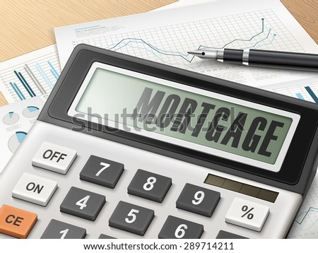 calculator with the word mortgage on the display - stock photo