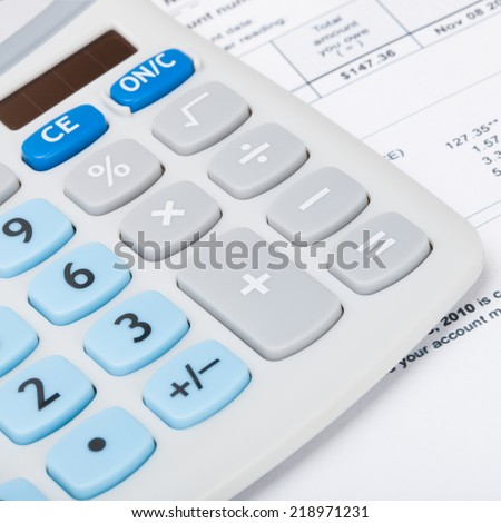 Calculator with utility bill under it - 1 to 1 ratio