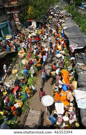 CALCUTTA - APRIL 2: busy activities at the Howrah flower market on April 2, 2008 in Calcutta, India. Locals come here to buy flowers for worshiping their gods. - stock photo