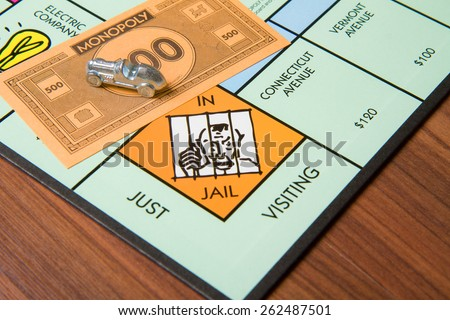 CALDWELL, IDAHO/USA - MARCH 16, 2015: Car from the monopoly game implying bribery - stock photo