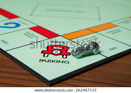 CALDWELL, IDAHO/USA - MARCH 16, 2015: Car pulling into the Free Parking spot in Monopoly - stock photo