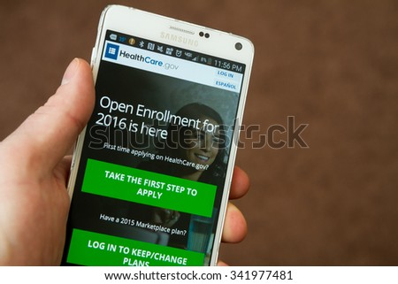 CALDWELL, IDAHO/USA NOVEMBER 18, 2015: Man getting ready to sign up on a mobile device for healthcare in Caldwell, Idaho - stock photo