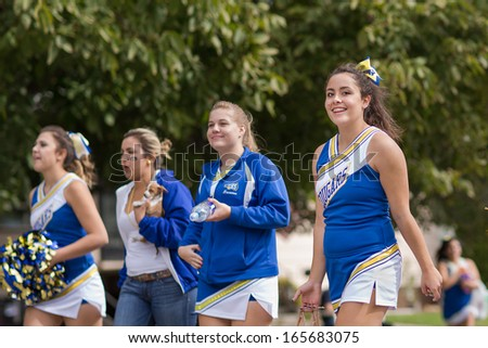 CALDWELL, IDAHO/USA - SEPTEMBER 27: One of the Caldwell High School Cheerleaders smile at the camera during the Caldwell High School Homecoming parade on September 27, 2013  - stock photo