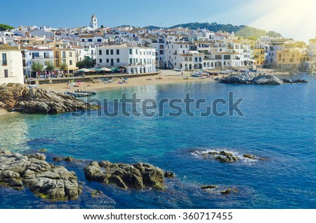 Calella de Palafrugell, whitewashed fisherman village on the Costa Brava, Catalonia, Spain. White houses on seaside. Coastal town Calella de Palafrugell in Spain. Summer travel to Spain.    - stock photo
