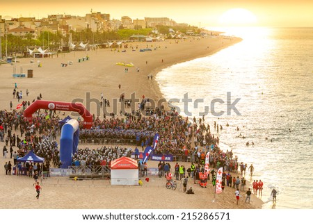 CALELLA MAY 18: Triathletes on start of the Ironman triathlon competition at Calella beach, May 18, 2014 in Calella, Spain  - stock photo