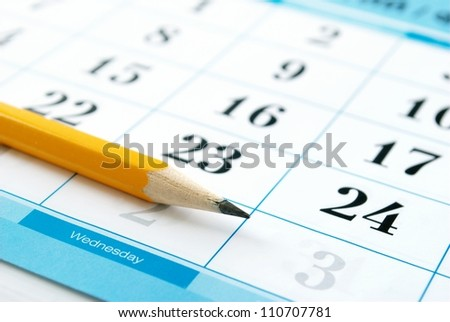 calendar and a pencil to mark the desired date - stock photo