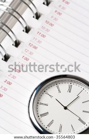 calendar and clock close up shot - stock photo