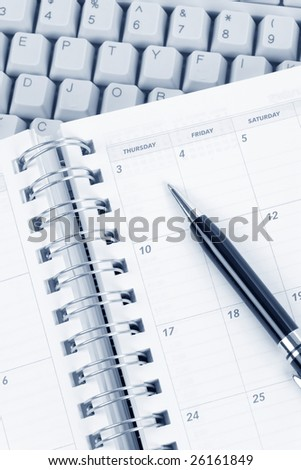 calendar and computer keyboard close up - stock photo
