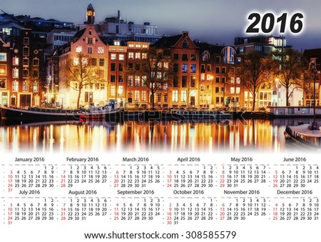 Calendar 2016. Beautiful night in Amsterdam. Night illumination of buildings and boats near the water in the canal. - stock photo