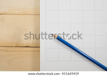 calendar date and pencil on wooden background - stock photo