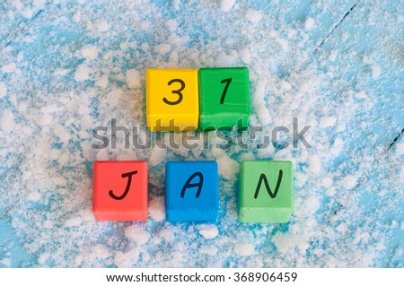 Calendar date on color wooden cubes with marked Date of 31st Of January - stock photo