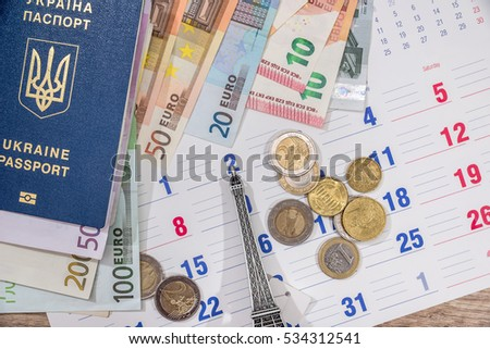 calendar, euro bills and coin with passport. travel concept.