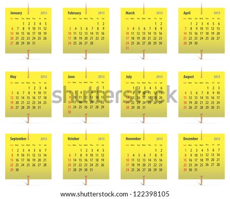 Calendar for 2013 on yellow stickers attached with toothpicks - stock photo