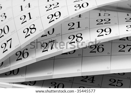Calendar fragment with half-opened sheets in different angles - stock photo