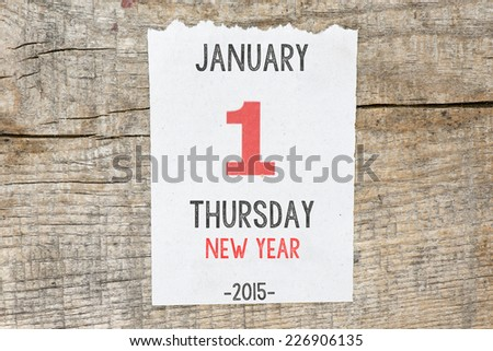 Calendar on old wooden wall. 1 January 2015 - stock photo