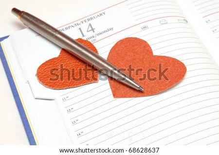 Calendar opened on 14 february - stock photo