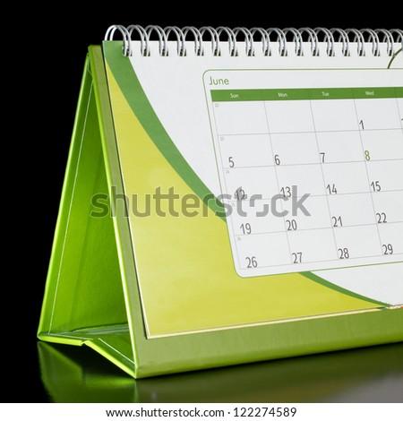 Calendar organizer on black background - stock photo