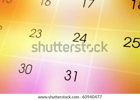 Calendar page on color background - stock photo