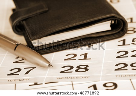 Calendar page, pen and pocket planner - stock photo