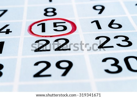 Calendar page with fifteenth day of month highlighted by red circle
