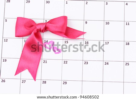 Calendar page with hearts and bow on St.Valentines Day