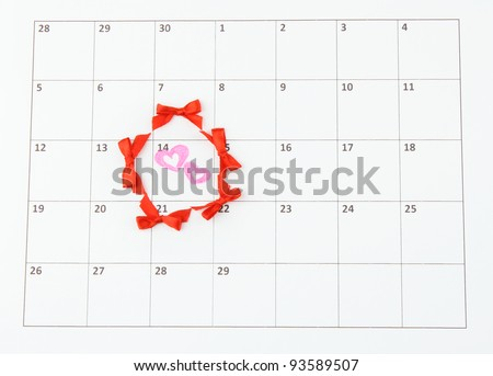 Calendar page with hearts and bows on St.Valentines Day - stock photo