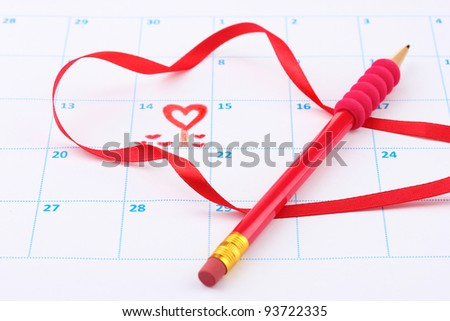 Calendar page with hearts, pencil and ribbon on St.Valentines Day