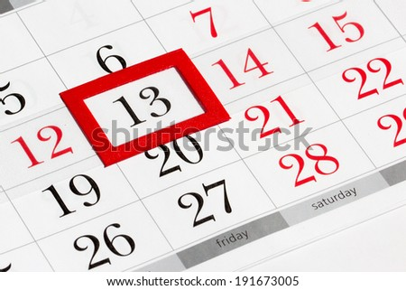 Calendar page with marked date of friday 13th - stock photo