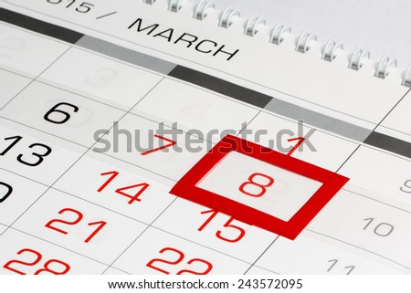 Calendar page with marked date of International Women's Day - stock photo