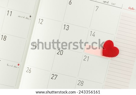 Calendar page with red heart and tag on 14 February - Valentine day