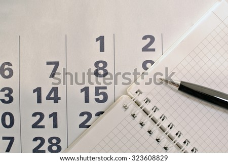 Calendar, pen and notebook with blank pages