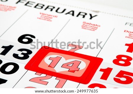 Calendar pointed on St.Valentine's day with heart symbol - stock photo