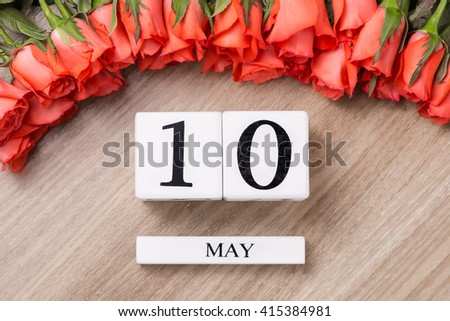 Calendar showing the date 10th of May which is the date of mothers day with spring flower.  International or World Press Freedom Day - stock photo