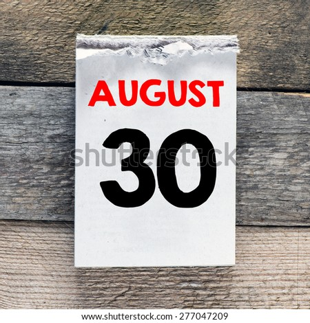 Calendar with 30 august on wooden background - stock photo