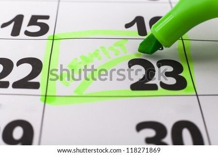Calendar with dentist appointment highlighted with green marker - stock photo